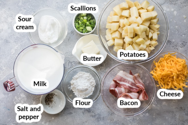 Labeled loaded baked potato soup ingredients in various bowls.
