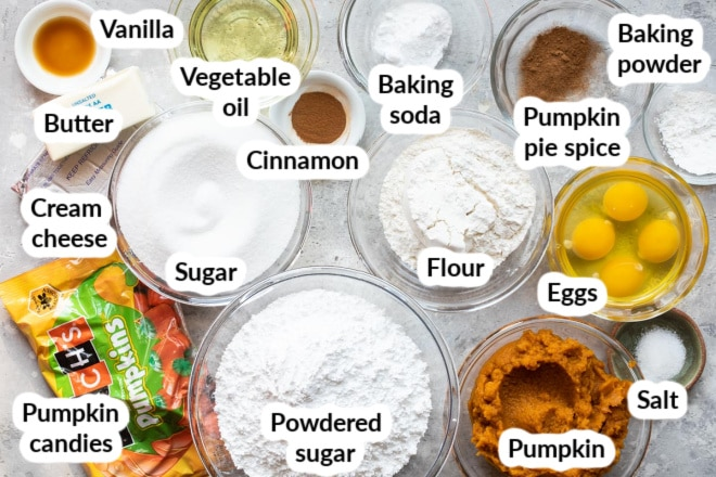 Labeled pumpkin pie ingredients in various bowls.