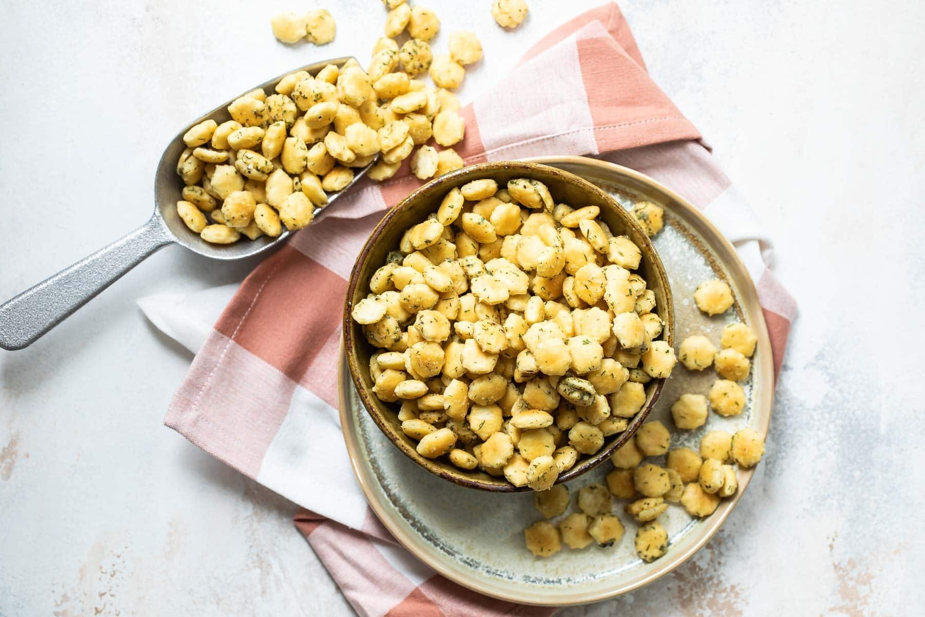 Ranch oyster crackers in a brown bowl.