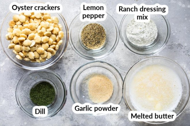 Labeled ingredients for ranch oyster crackers in various bowls.