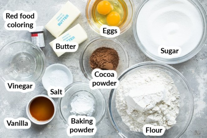 Labeled ingredients for red velvet cookies in various bowls.
