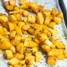 Roasted butternut squash on a baking sheet.