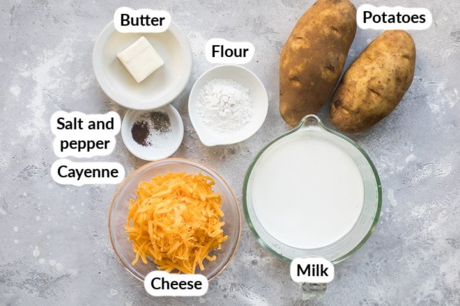Labeled ingredients for scalloped potatoes in various bowls.