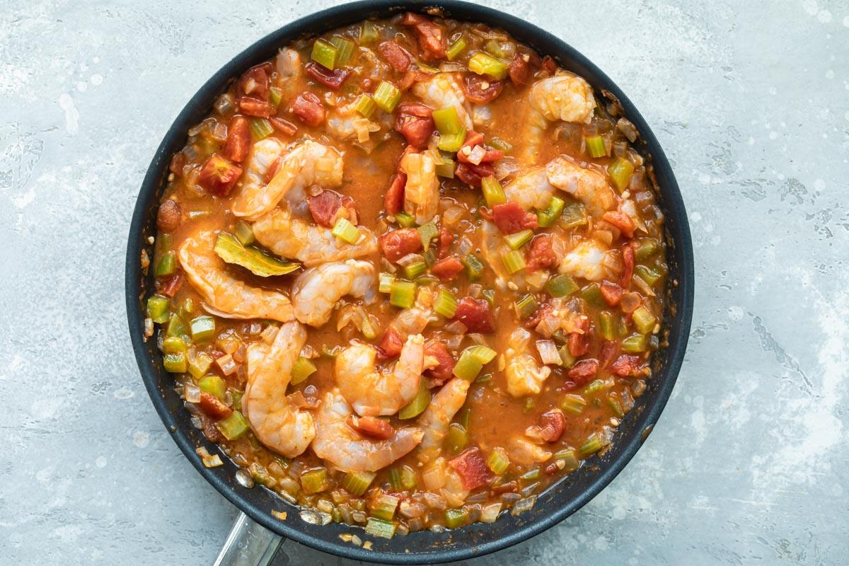 Shrimp creole in a black skillet.