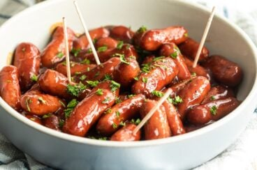 Barbecue little smokies in a white bowl.