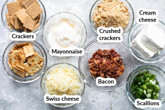 Cheesy bacon dip ingredients in various bowls.
