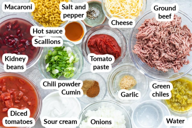 Labeled chili mac ingredients in various bowls.