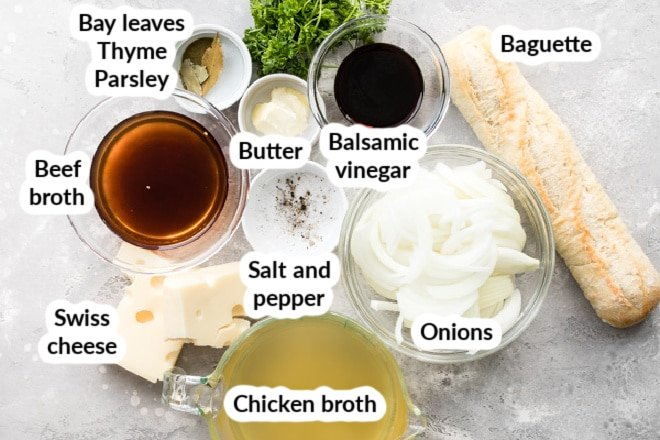 Labeled French onion soup ingredients in various bowls.