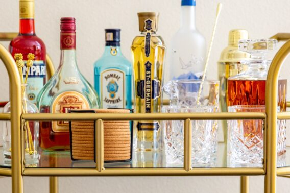 The top tier of a stocked bar cart.