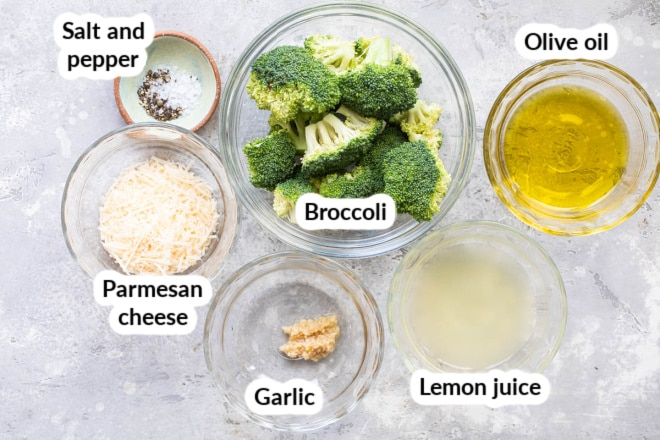 Labeled roasted broccoli ingredients in various bowls.