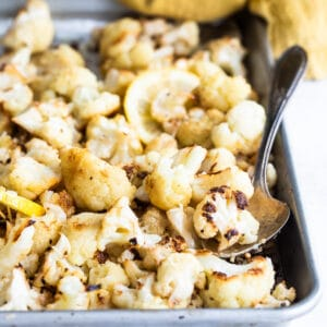 Roasted cauliflower on a baking sheet.