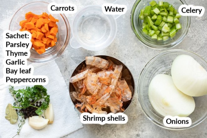 Labeled shrimp stock ingredients in various bowls.