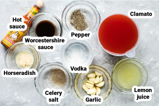 Labeled Bloody Mary ingredients in various bowls.