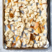 Cubes of bread on a baking sheet to try out for stuffing.