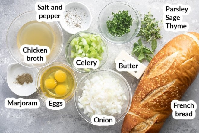 Bread stuffing ingredients labeled in bowls.