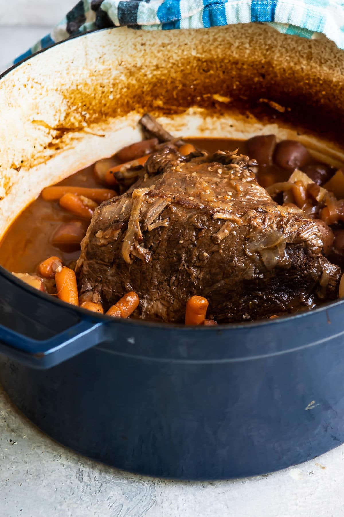 Cooked pot roast in a Dutch oven.