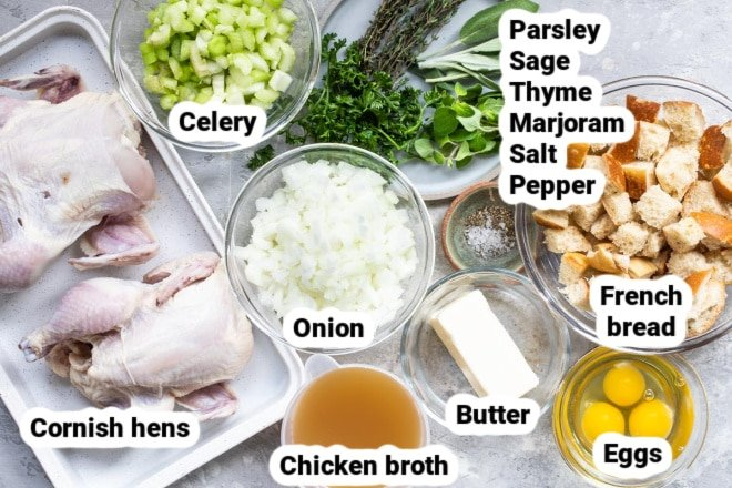 Labeled Cornish hens with stuffing ingredients in various dishes.