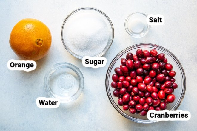 Ingredients for Cranberry Sauce in bowls and labeled.