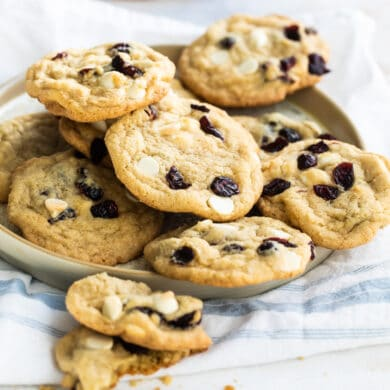 Cranberry cookies with white chocolate on a gray plate.
