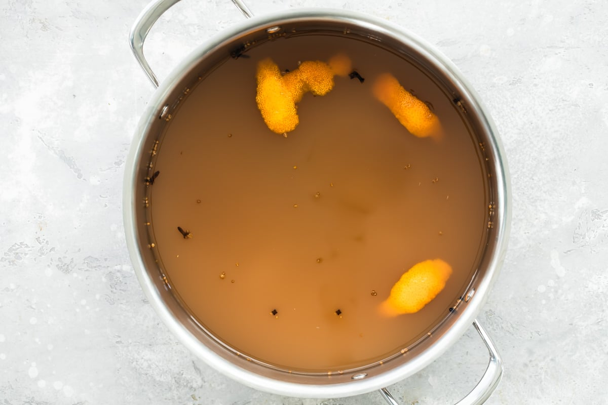 Mulled cider in a silver stock pot.