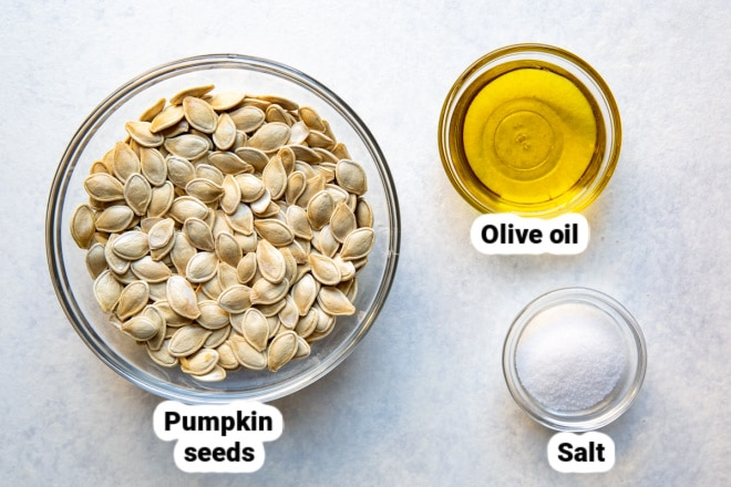 Labeled roasted pumpkin seed ingredients in various bowls.