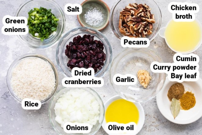Labeled rice stuffing ingredients in various bowls.