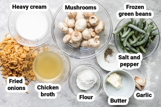 Slow cooker green bean casserole ingredients labeled and in various bowls.