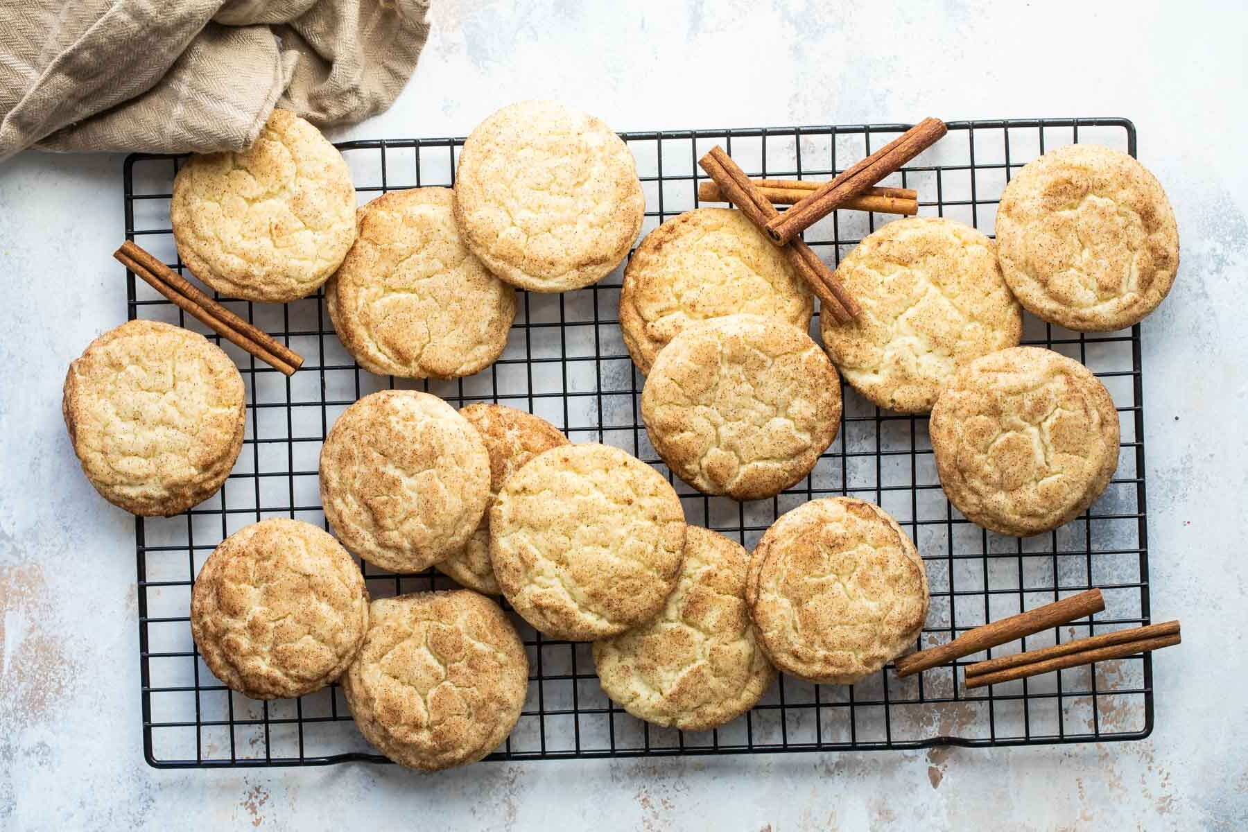 Snickerdoodle cookies on a baking rack.