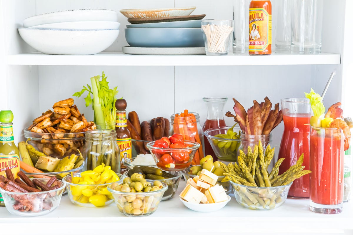 A bloody mary bar with all the garnishes.
