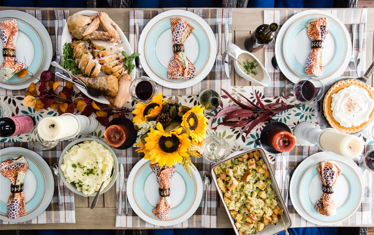 A complete make-ahead Thanksgiving meal on a decorated table.