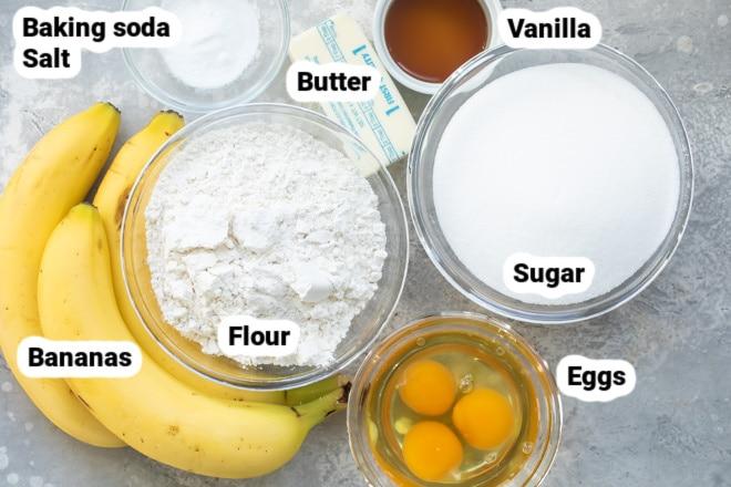 Labeled banana bar ingredients in various bowls.