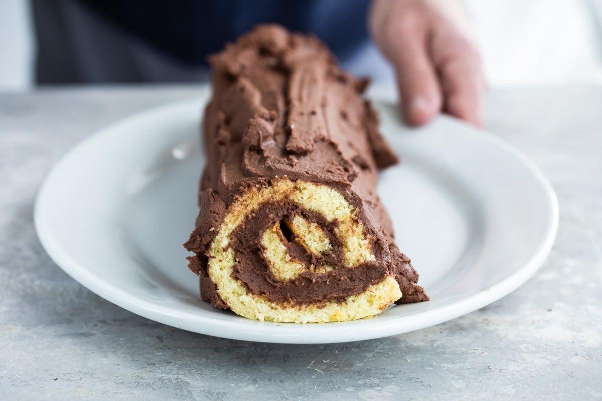 A Buche de Noel (yule log cake) on a platter.