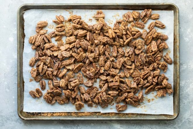 Candied pecans on a baking sheet.