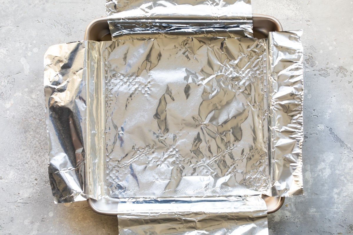 A 9-inch square baking pan lined with foil.