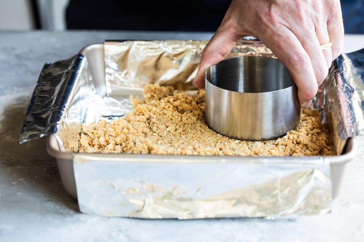 Pressing graham cracker crumbs