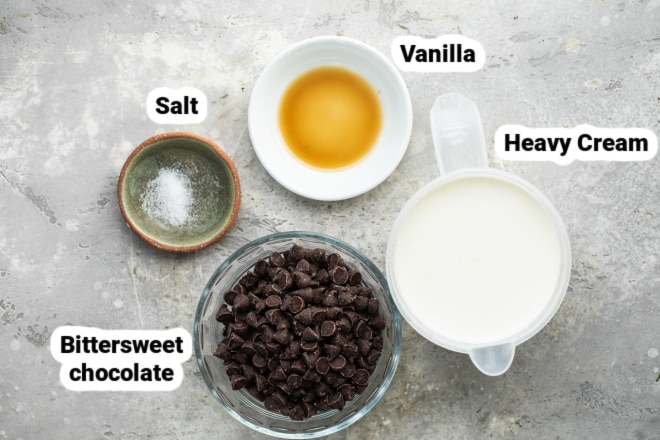 Labeled chocolate frosting ingredients in various bowls.