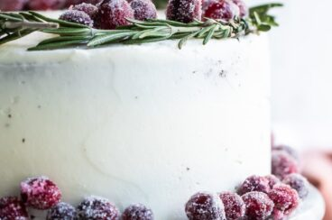 A cranberry wreath cake on a granite cake platter.