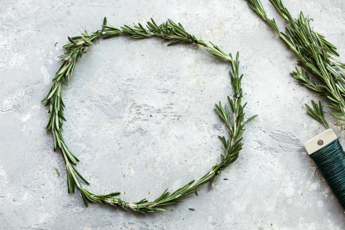 Fresh rosemary formed into a wreath with floral wire.