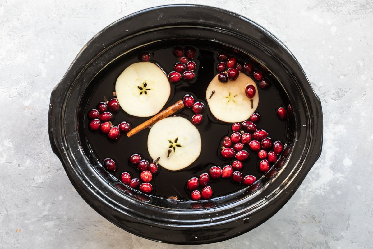 Slow cooker cranberry apple cider in a crockpot.