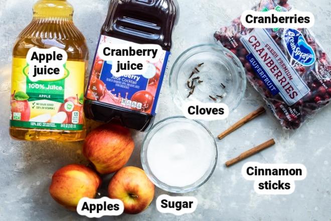 Labeled slow cooker cranberry apple cider ingredients.