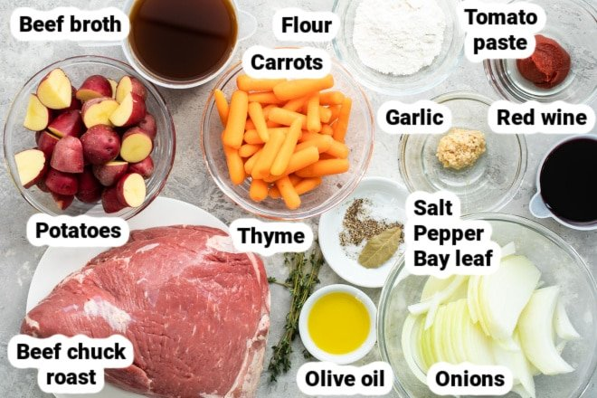 Pot roast ingredients labeled and in bowls.