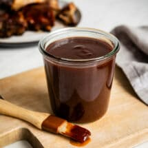 Barbecue sauce in a glass jar.