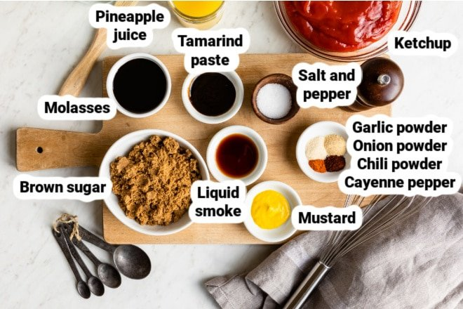 Labeled ingredients for barbecue sauce in various bowls.