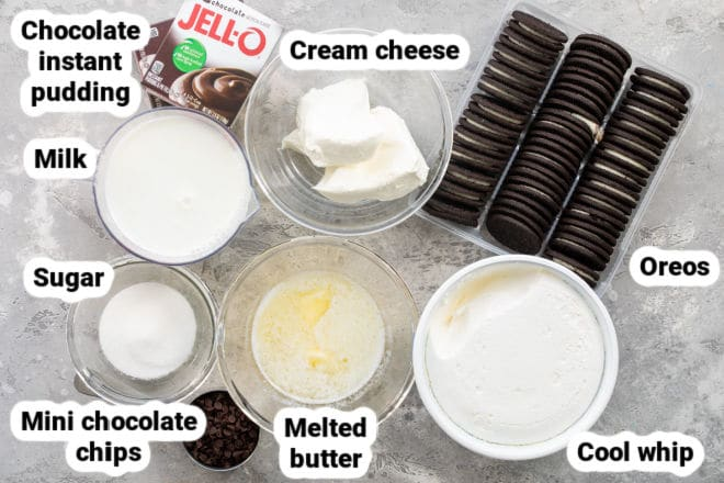 Labeled chocolate lasagna ingredients on a counter in various bowls.