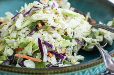 Coleslaw in a teal bowl.