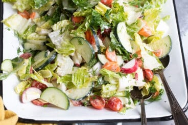 Easy garden salad on a white platter.