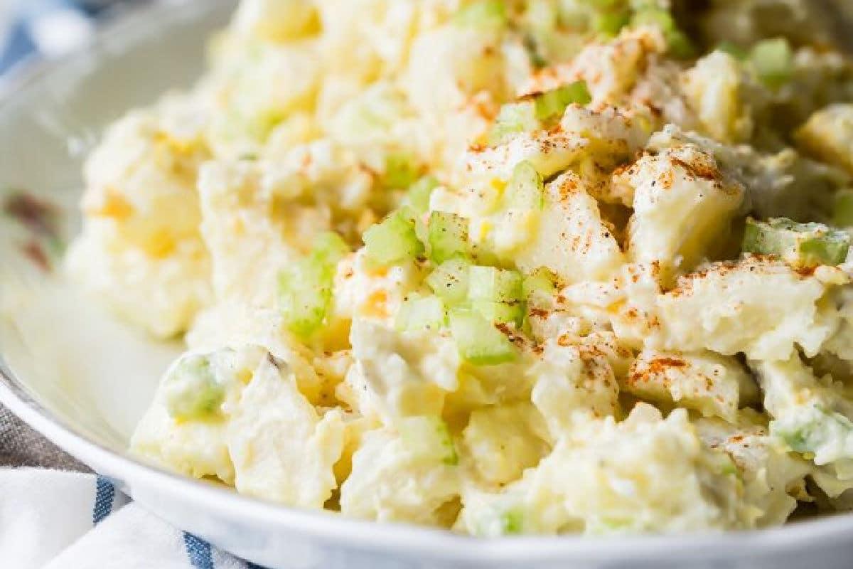 Potato salad on a white plate.