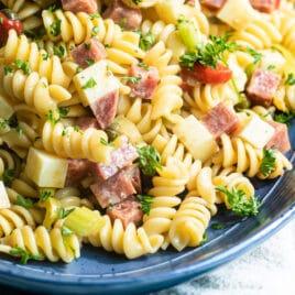 Italian pasta salad on a blue platter.