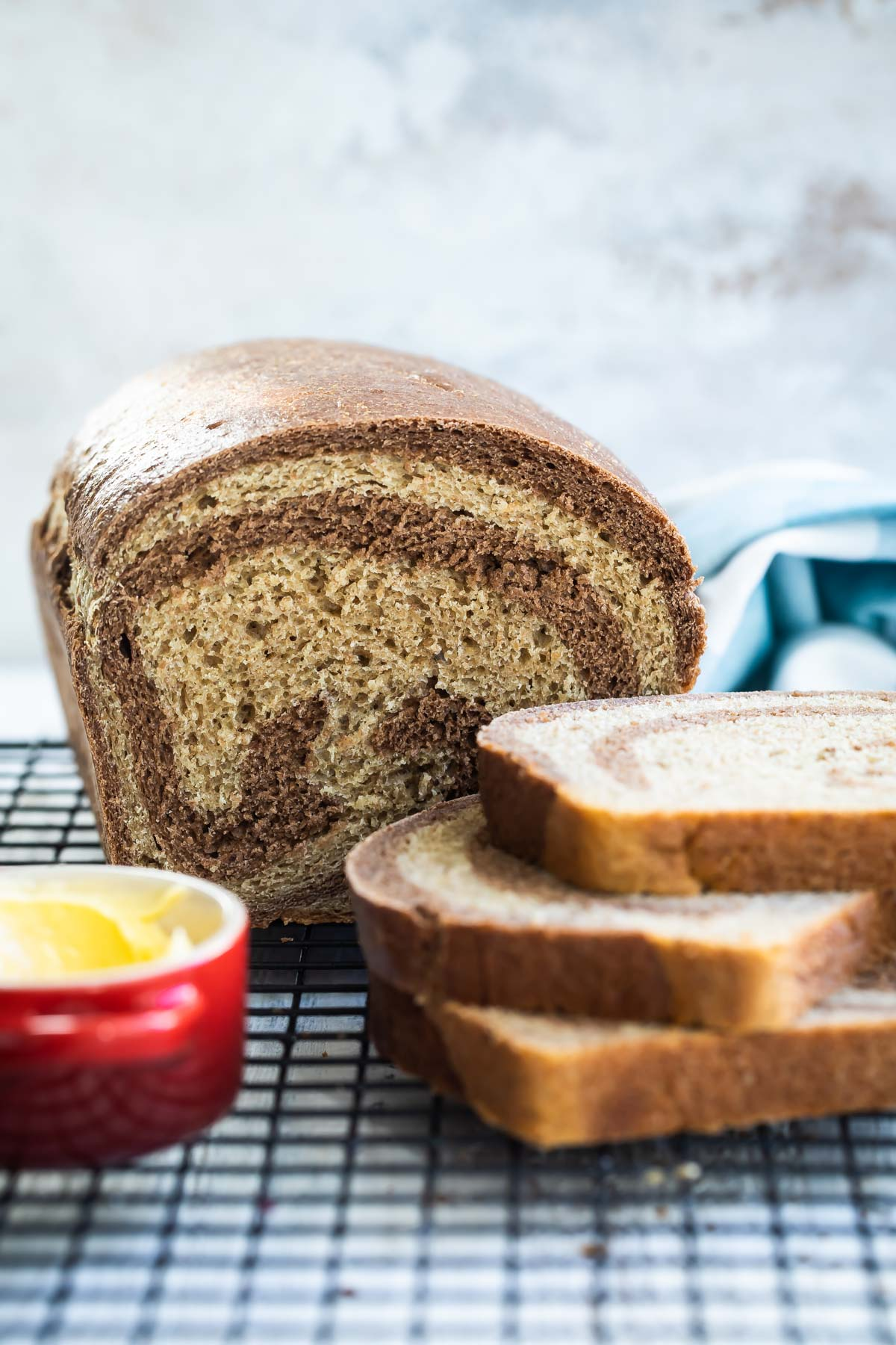 Marble rye bread on a cooling rack.