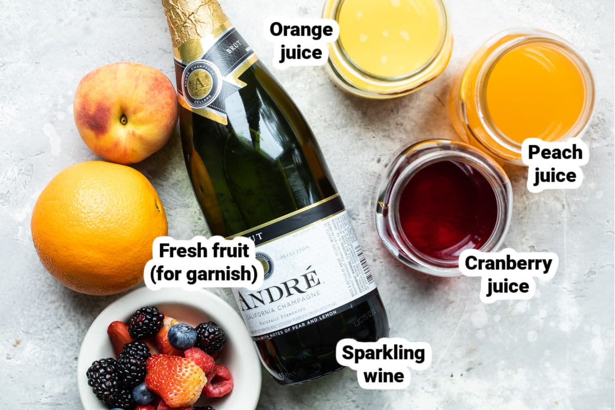 Ingredients for a mimosa bar labeled.